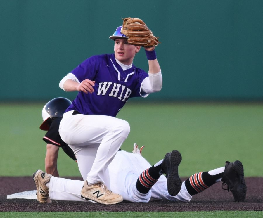 Hampshire's Caden Pyszka holds up the ball but Edwardsville's Aaron Young is safe at second base with a steal during the Class 4A state baseball semifinal in Joliet Friday.