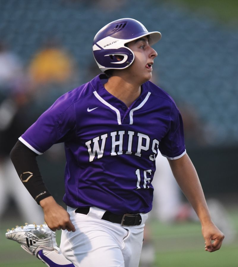 Hampshire's Thomas Ugalde hustles to first base after putting the ball in play during the Class 4A state baseball semifinal against Edwardsville in Joliet Friday.