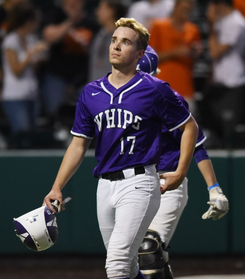 Hampshire's Logan Nespor (17) walks off the field after his team's 2-0 loss to Edwardsville during the Class 4A state baseball semifinal in Joliet Friday.