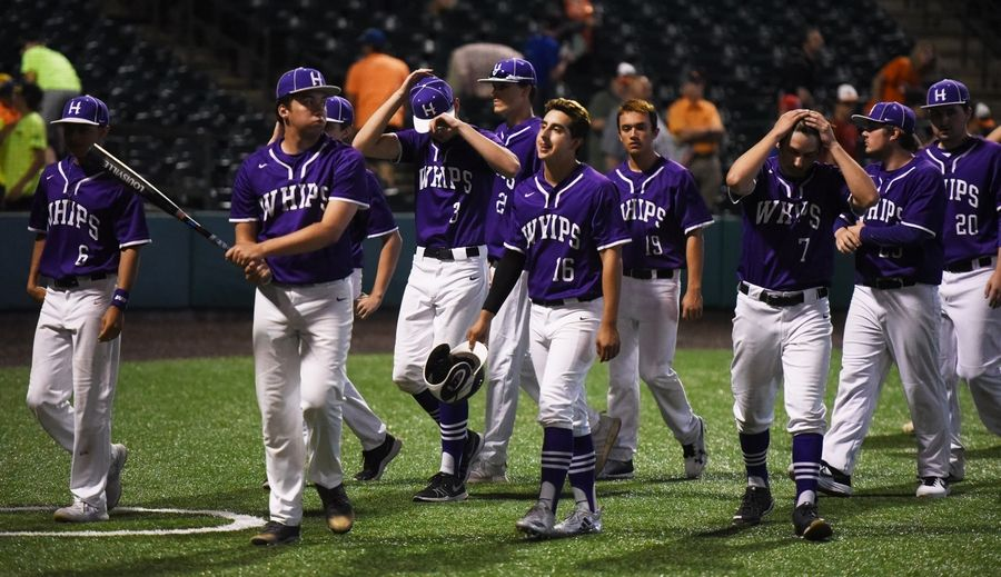 Hampshire players react to their team's 2-0 loss to Edwardsville during the Class 4A state baseball semifinal in Joliet Friday.