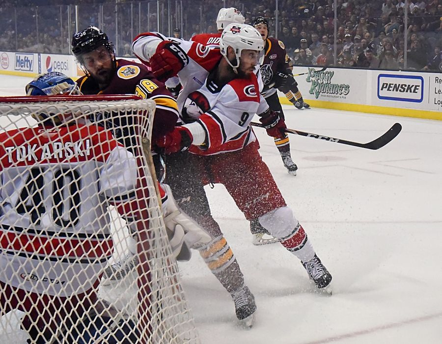John Starks/jstarks@dailyherald.comCharlotte Checkers' Tomas Jurco tries to get in the way of a Chicago Wolves shot in Game 4 of the Calder Cup finals at the Allstate Arena in Rosemont Thursday.