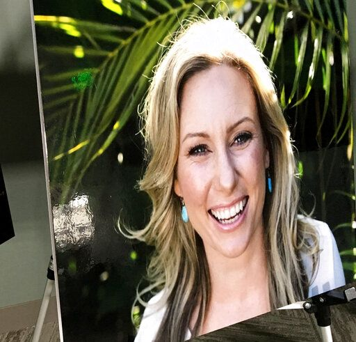 FILE - In this July 23, 2018, file photo, a poster of Justine Ruszczyk Damond is displayed at a news conference by attorneys for her family in Minneapolis. Attorneys for Mohamed Noor, a Minneapolis police officer convicted of murder in the shooting of Damond, an unarmed woman who had called 911, are asking a judge to give him a creative sentence rather than send him to prison. Noor's lawyers said in papers filed ahead of his Friday, June, 7, 2019, sentencing hearing that he should instead be required to report to county detention on Damond's birthday and the anniversary of her death.