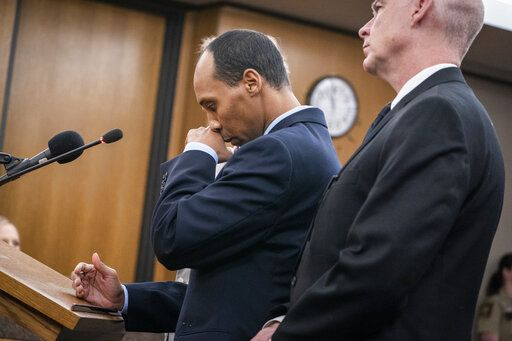 Former Minneapolis police officer Mohamed Noor reads a statement in Hennepin County District Court in Minneapolis Friday, June 7, 2019, before being sentenced by Judge Kathryn Quaintance in the fatal shooting of Justine Ruszczyk Damond.  (Leila Navidi/Star Tribune via AP, Pool)