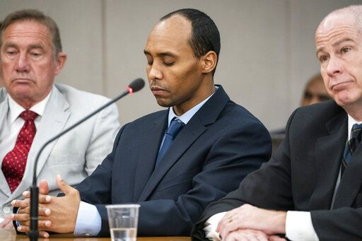 Former Minneapolis police officer Mohamed Noor listens to victim impact statements during his sentencing hearing with his lawyers Peter Wold, left, and Thomas Plunkett at the Hennepin County District Court Friday, June 7, 2019, in Minneapolis, before being sentenced by Judge Kathryn Quaintance in the fatal shooting of Justine Ruszczyk Damond. (Leila Navidi/Star Tribune via AP, Pool)