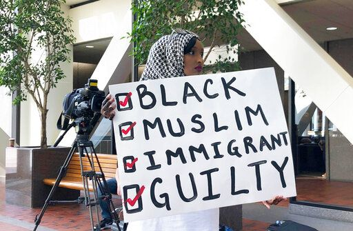 Muna Abdi of Minneapolis stands outside the courtroom during the sentencing of Mohamed Noor on Friday, June 7, 2019 in Minneapolis. A jury convicted Noor in April of third-degree murder and second-degree manslaughter in the July 2017 death of Damond, a 40-year-old dual citizen of the U.S. and Australia.  Noor shot Damond when she approached his squad car in the alley behind her home. Abdi said Noor was treated differently because he is a black Muslim and she wanted to stand in solidarity with him.