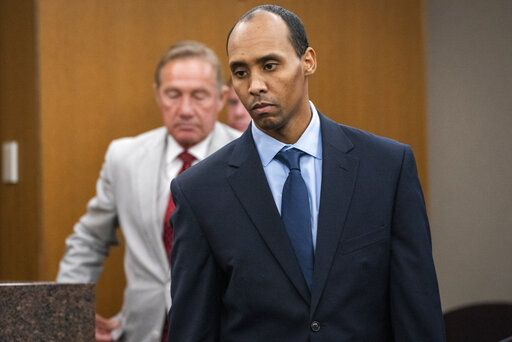 Former Minneapolis police officer Mohamed Noor walks to the podium to be sentenced at Hennepin County District Court Friday, June 7, 2019, in Minneapolis, before being sentenced by Judge Kathryn Quaintance in the fatal shooting of Justine Ruszczyk Damond. (Leila Navidi/Star Tribune via AP, Pool)