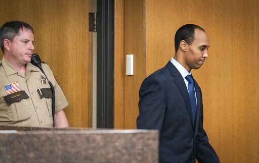 Former Minneapolis police officer Mohamed Noor enters the courtroom for his sentencing hearing at Hennepin County District Court Friday, June 7, 2019, in Minneapolis, before being sentenced by Judge Kathryn Quaintance in the fatal shooting of Justine Ruszczyk Damond. (Leila Navidi/Star Tribune via AP, Pool)
