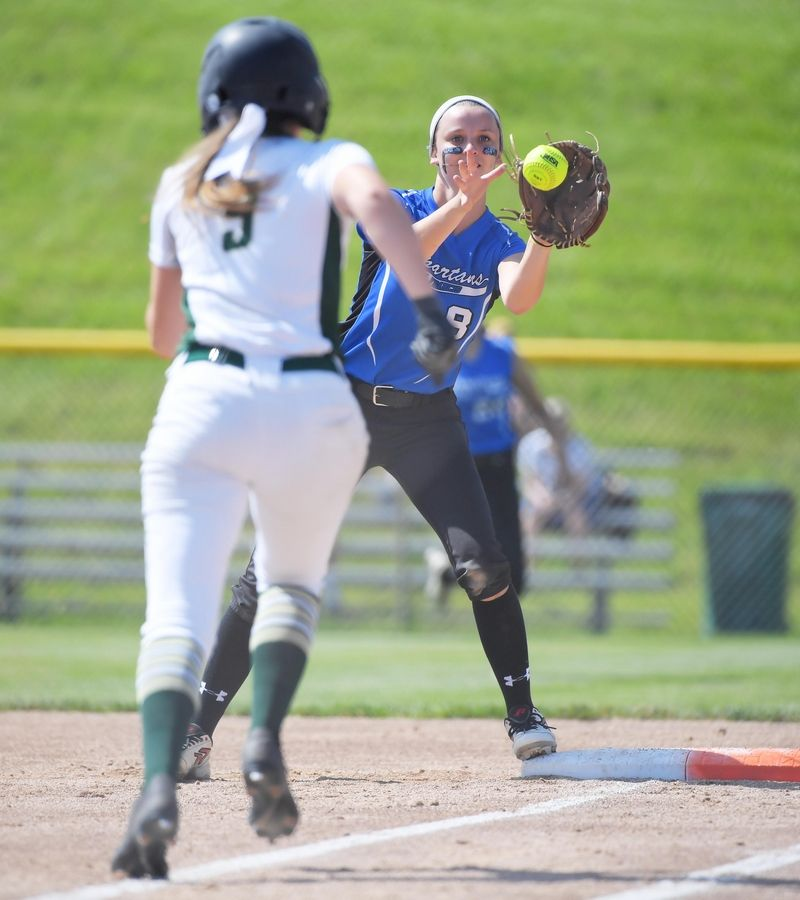 St. Francis' Bridget Rath covers first base to force out Bishop McNamara's Gillian McDermott for the first out of the first inning in the Class 3A state softball semifinal game in Peoria Friday.