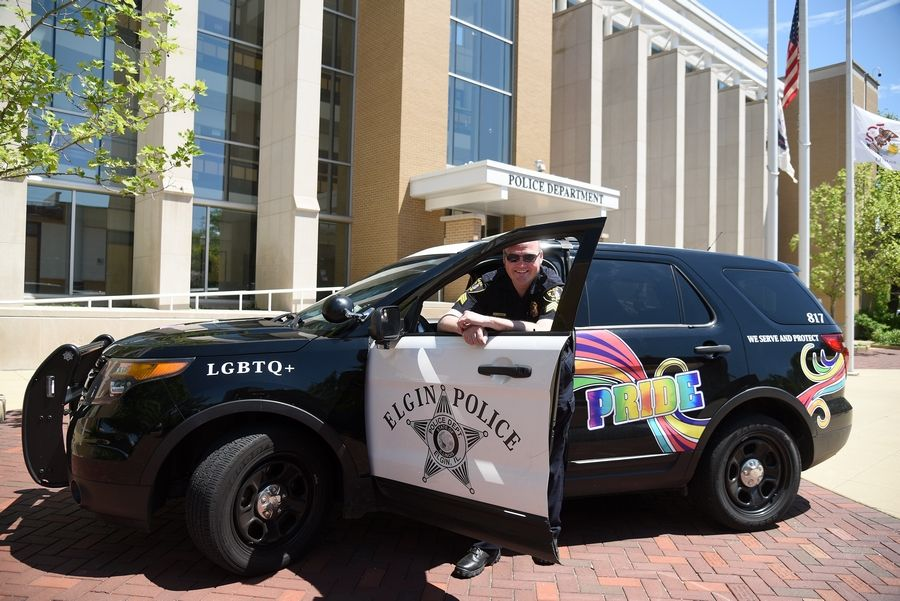 Elgin police Sgt. Travis Hooker is taking on the role of LGBTQ liaison for the Elgin Police Department, which this month is sporting a vehicle honoring the LGBTQ community that will be in today's Aurora Pride Parade.