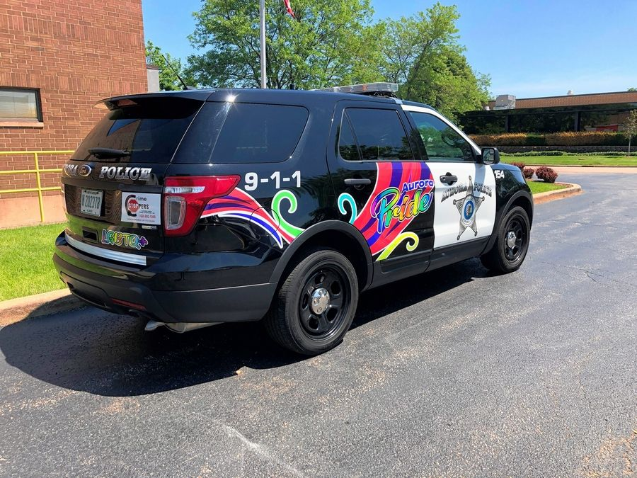 The Aurora Police Department followed Elgin's example and now has an LGBTQ pride vehicle that will participate in today's Aurora Pride Parade.