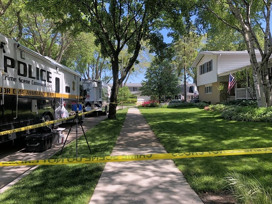 Arlington Heights police found a man and woman with traumatic injuries early Saturday inside their home on South Derbyshire Lane. Police are investigating it as a double homicide and have a person of interest in custody.