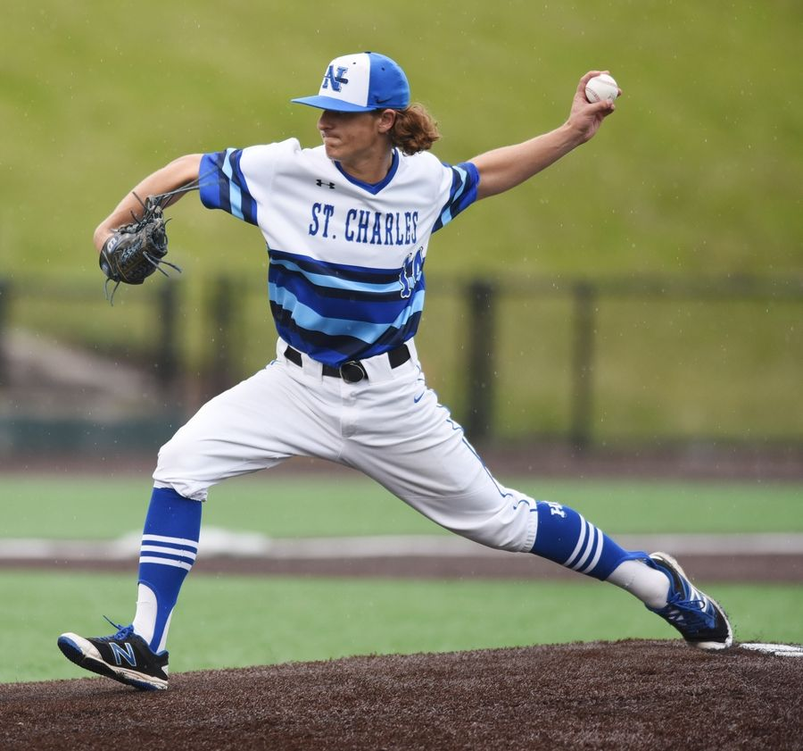 St. Charles North relief pitcher Johnny Lambert delivers during the Class 4A state baseball championship game against Edwardsville in Joliet Saturday.
