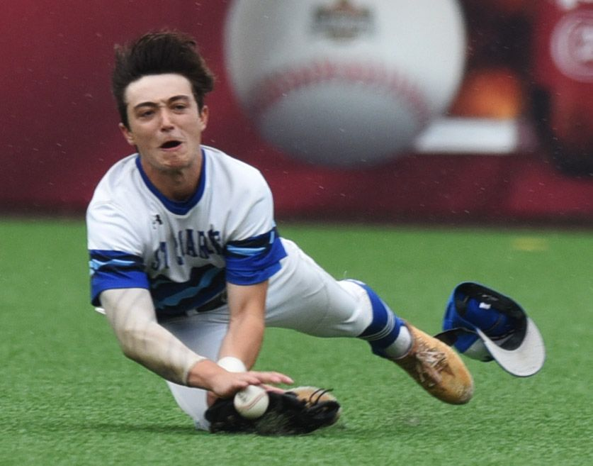 St. Charles North left fielder Pat Bellock makes a diving catch.