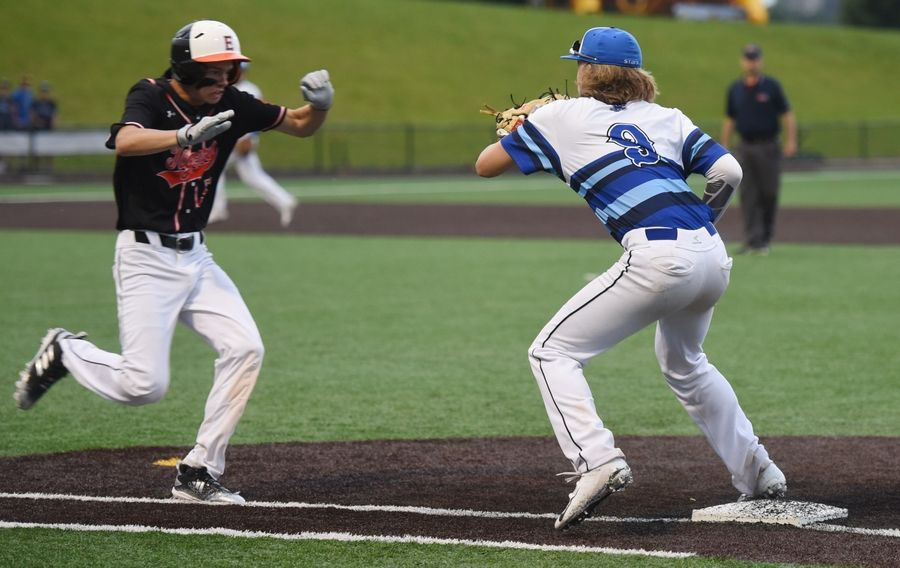 Edwardsville's Blake Burris arrives safely at first base as St. Charles first baseman Kyler Brown is unable to glove the throw during the eighth inning of the Class 4A state baseball championship game in Joliet Saturday.