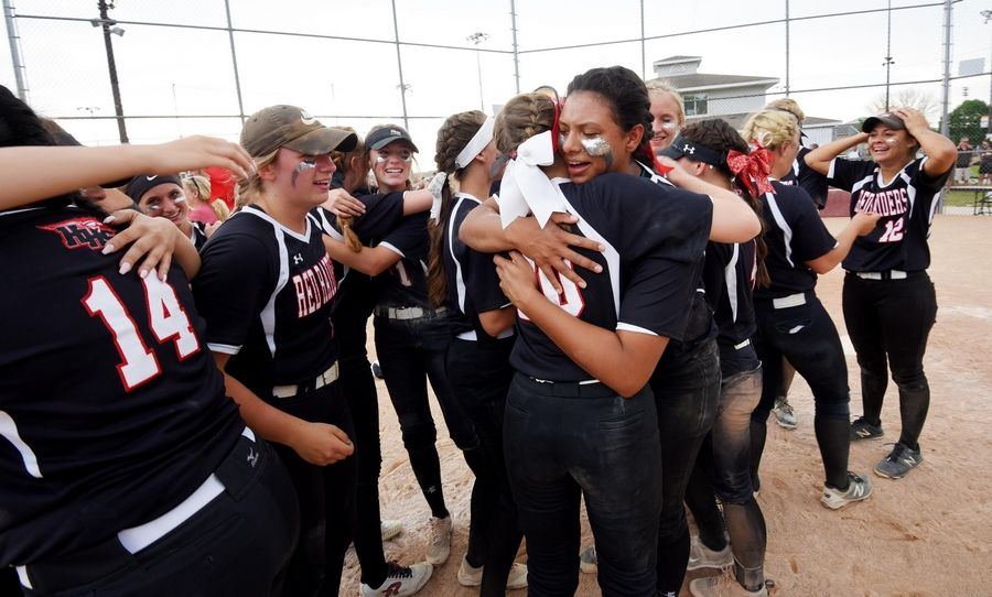 Huntley pitcher Bianna Bower hugs Madeline Rainey after the Red Raiders beat St. Charles East in eight innings in the Class 4A state softball final game in Peoria Saturday.