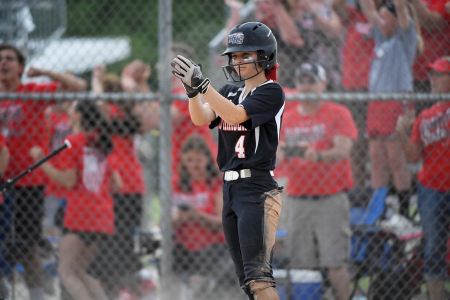 Huntley's Taylor Zielinski applauds after scoring in the eighth inning against St. Charles in the Class 4A state softball final game in Peoria Saturday.
