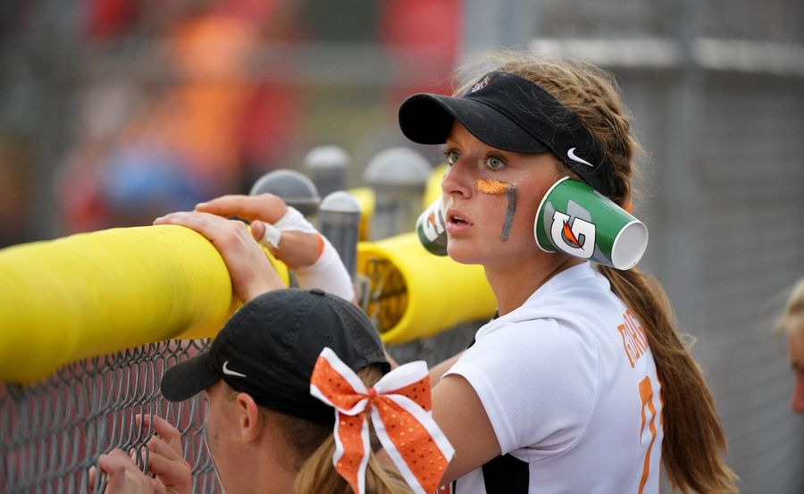 St. Charles East's Kati Gheorghe wears cups on her ears late in the Class 4A state softball final game against Huntley in Peoria Saturday.