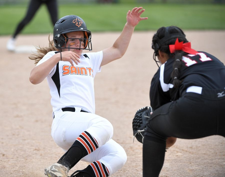 St. Charles East's Kayla Richarson is tagged out at third by Huntley's Briana Bower in the Class 4A state softball final game in Peoria Saturday.