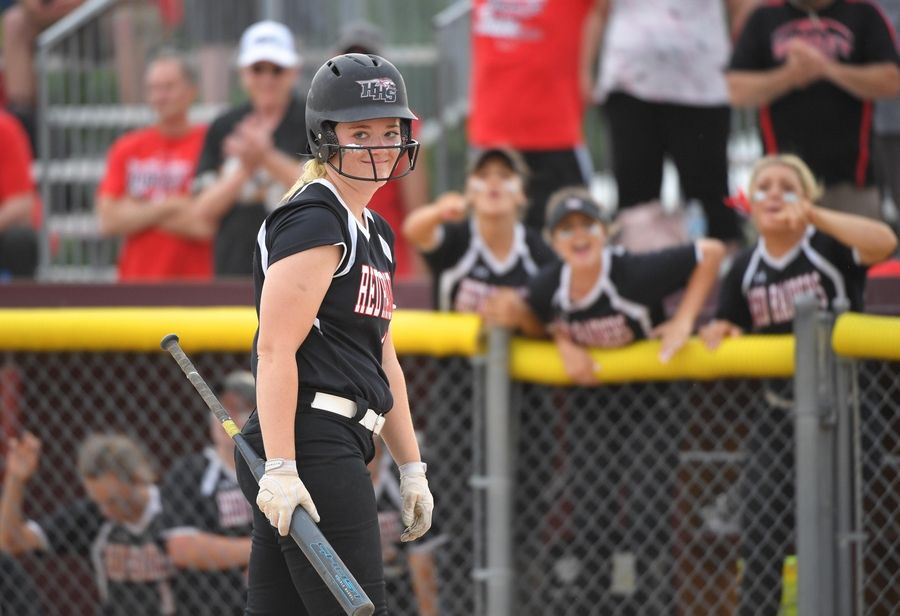 Huntley's Grace Kutz smiles after hitting a long foul ball late  in the Class 4A state softball final game against St. Charles East in Peoria Saturday.
