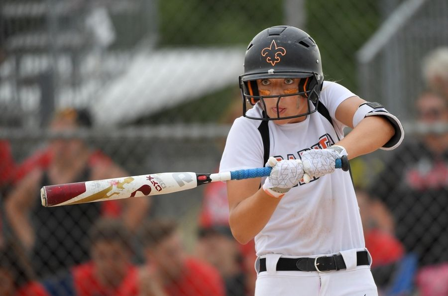 St. Charles East's Kati Gheorghe swings the bat as she looks at her coach for signals during a seventh inning at-bat against Huntley in the Class 4A state softball final game in Peoria Saturday.