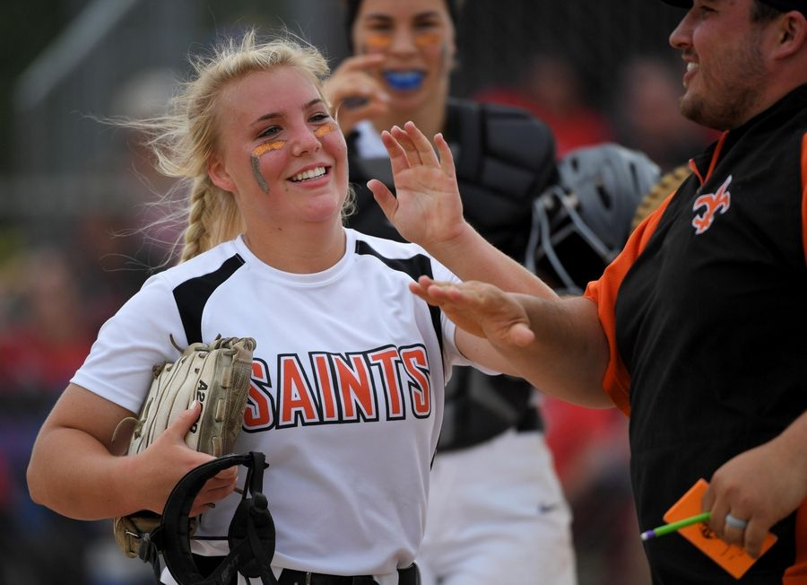 St. Charles East's Katie Arrambide comes off the field after getting out of the sixth inning with Huntley runners on base and the score tied at zero in the Class 4A state softball final game in Peoria Saturday.