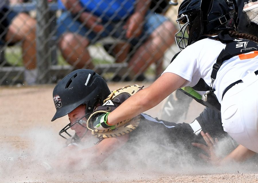 Huntley's Marley Reicher is tagged out by St. Charles East catcher Paige Ligocki to end the second inning in the Class 4A state softball final game in Peoria Saturday.