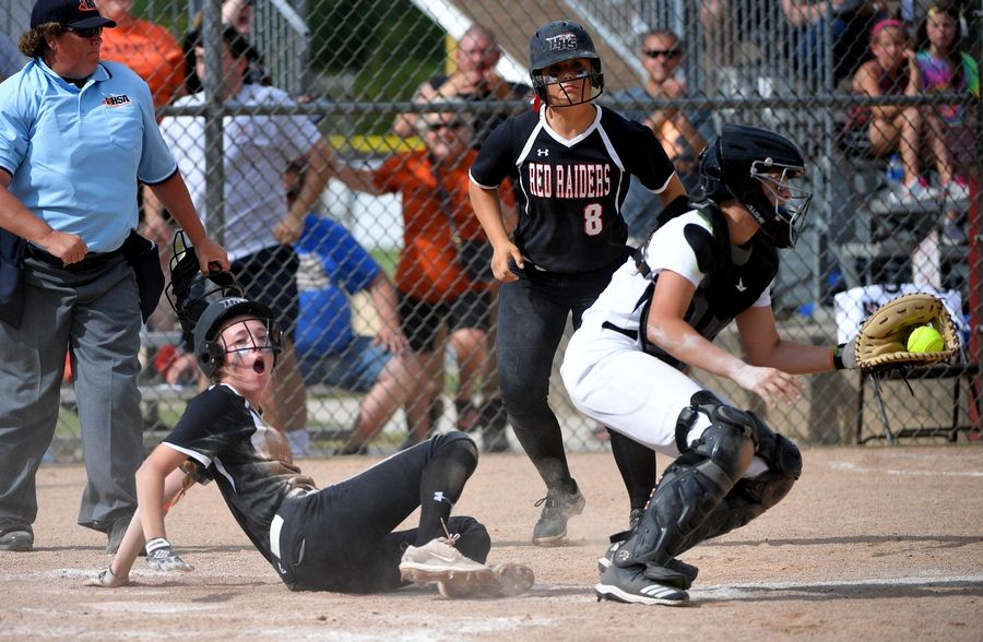 Huntley's Marley Reicher reacts after being tagged out by St. Charles East catcher Paige Ligocki to end the second inning in the Class 4A state softball final game in Peoria Saturday.