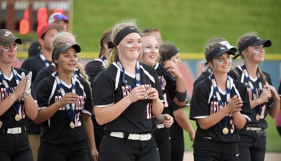Huntley's Grace Kutz smiles with teammates during the trophy presentation ceremony in the Class 4A state softball final game in Peoria Saturday.