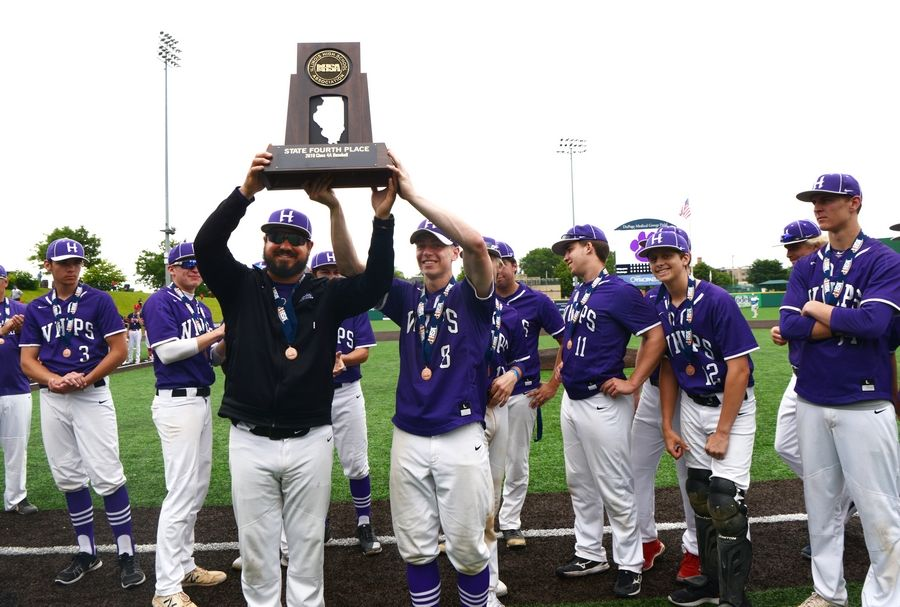 Hampshire coach Frank Simoncelli, left, and Andrew Krajecki hold the fourth-place trophy at the conclusion of the Class 4A state third-place game against St. Rita in Joliet Saturday.