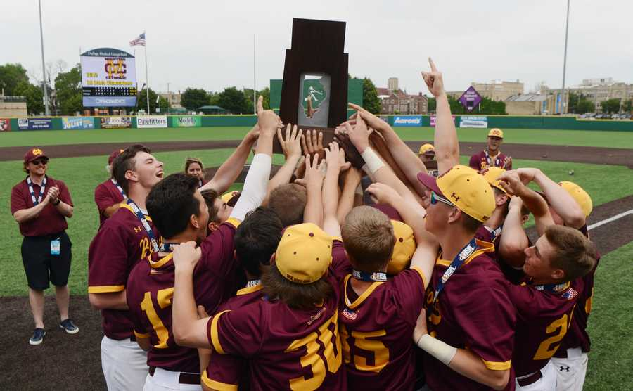 Montini players celebrate their Class 3A baseball state championship after defeating St. Laurence 6-3 in Joliet Saturday.