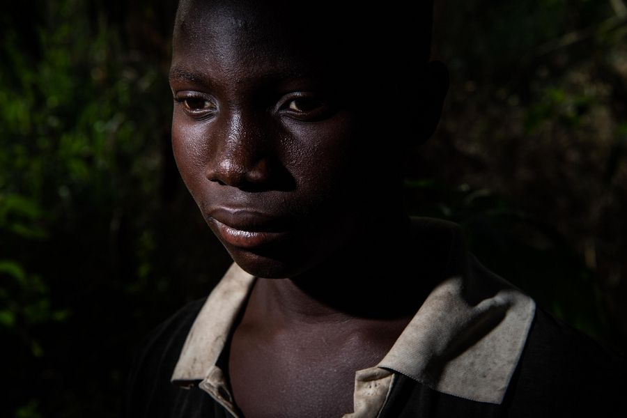 Abou Ouedrago, 15, from Burkina Faso, is like many teen boys on the cocoa farms who sleep in huts out in the woods, spend their days doing hard manual labor and don't attend school or see their families.