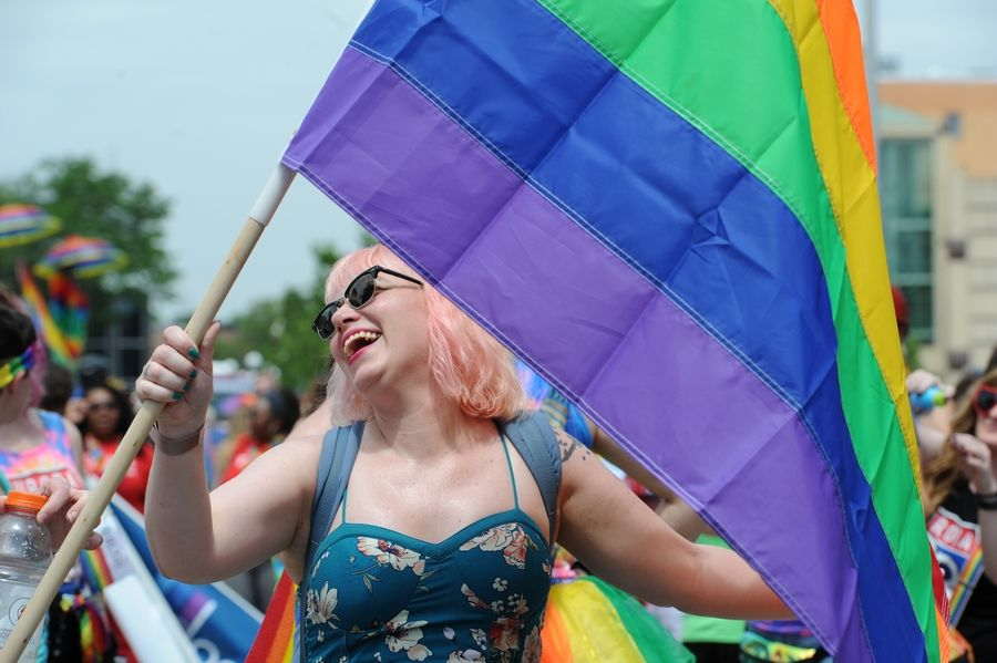 Sandra Law of Clarendon Hills marches Sunday in the second annual Aurora Pride Parade.