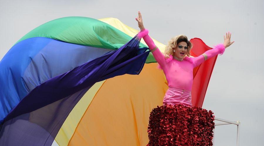 J. Tyler Whitmer of Chicago adds color to the second annual Aurora Pride Parade Sunday.