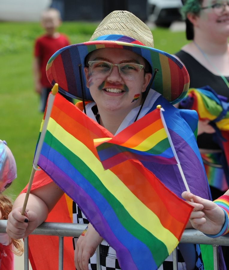 "Elliot Haxton, 14, of Lombard supported the second annual Aurora Pride Parade on Sunday. ""I think its awesome. It's really cool to see everyone supporting the LGBT community,"" he said."