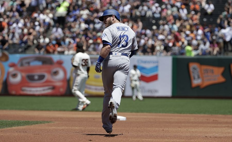 Los Angeles Dodgers' Max Muncy rounds the bases after hitting a solo home run off of San Francisco Giants pitcher Madison Bumgarner during the first inning of a baseball game in San Francisco, Sunday, June 9, 2019.