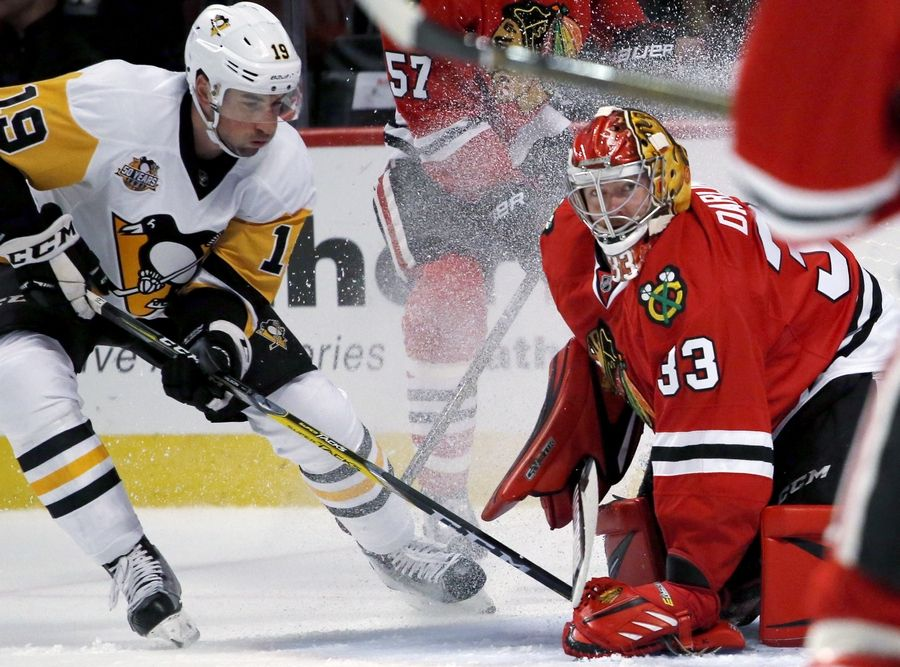 Chicago Blackhawks goalie Scott Darling, right, makes the save on a shot by Pittsburgh Penguins forward Garrett Wilson during the first period of an NHL preseason hockey game Wednesday, Sept. 28, 2016, in Chicago.