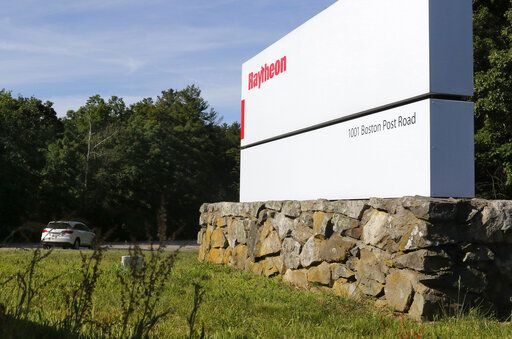 A car drives into the Raytheon facility Monday, June 10, 2019, in Marlborough, Mass. Raytheon Co. and United Technologies Corp. are merging in a deal that creates one of the world's largest defense companies.