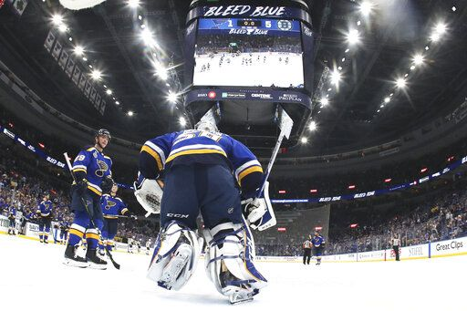 St. Louis Blues goaltender Jordan Binnington (50) skates to the bench after the Blues lost to the Boston Bruins in Game 6 of the NHL hockey Stanley Cup Final Sunday, June 9, 2019, in St. Louis. The Bruins won 5-1 to even the series 3-3. (Bruce Bennett/Pool via AP)