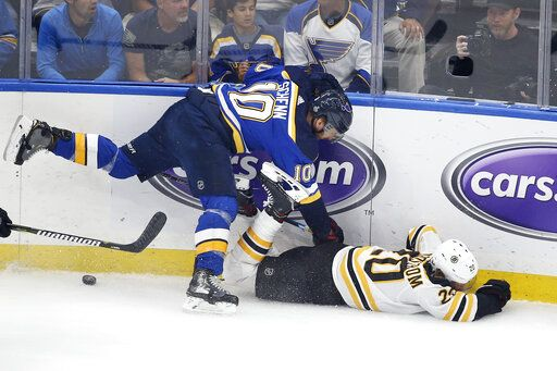 Boston Bruins center Joakim Nordstrom (20), of Sweden, falls as he chases the puck with St. Louis Blues center Brayden Schenn (10) during the first period of Game 6 of the NHL hockey Stanley Cup Final Sunday, June 9, 2019, in St. Louis.