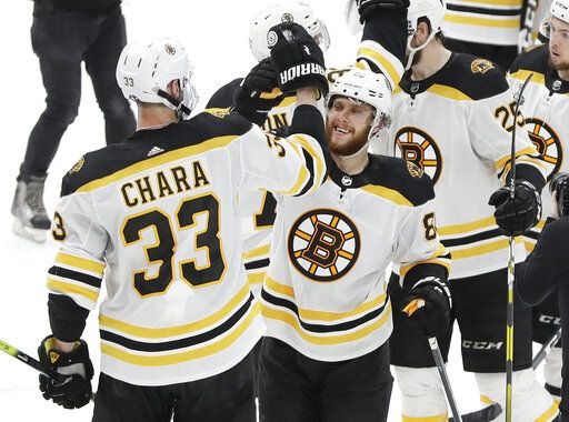 Boston Bruins defenseman Zdeno Chara (33), of Slovakia, celebrates with right wing David Pastrnak (88), of the Czech Republic, after the Bruins beat the St. Louis Blues in Game 6 of the NHL hockey Stanley Cup Final Sunday, June 9, 2019, in St. Louis. Both players scored goals as the Bruins won 5-1 to even the series 3-3.