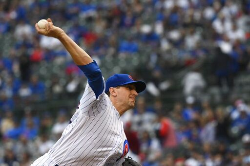 Chicago Cubs starting pitcher Kyle Hendricks delivers during the first inning of a baseball game against the St. Louis Cardinals, Sunday, June 9, 2019, in Chicago.