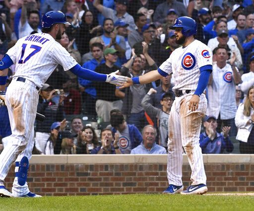 Chicago Cubs' David Bote, right, high fives Kris Bryant (17) after he scores against the St. Louis Cardinals during the fifth inning of a baseball game Sunday, June 9, 2019, in Chicago.