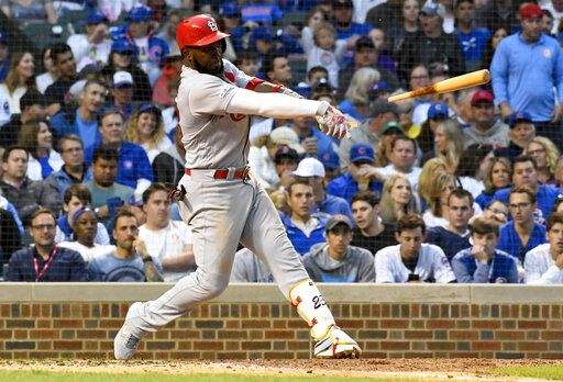 St. Louis Cardinals' Marcell Ozuna breaks his bat during the sixth inning of a baseball game against the Chicago Cubs, Sunday, June 9, 2019, in Chicago.