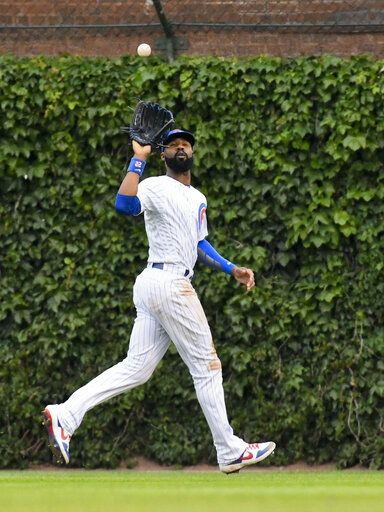 Chicago Cubs right fielder Jason Heyward catches a ball hit by St. Louis Cardinals' Paul Goldschmidt during the third inning of a baseball game Sunday, June 9, 2019, in Chicago.