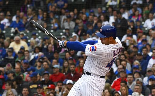 Chicago Cubs' Anthony Rizzo hits a sacrifice RBI during the first inning of a baseball game against the St. Louis Cardinals, Sunday, June 9, 2019, in Chicago.