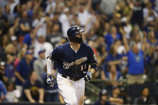Milwaukee Brewers' Mike Moustakas watches his two- run home run against the Pittsburgh Pirates during the eighth inning of a baseball game, Sunday, June 9, 2019, in Milwaukee.