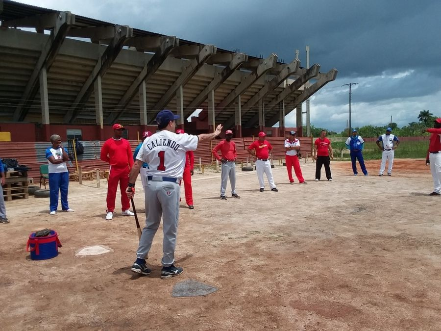 After plenty of classroom work, baseball coach Peter Caliendo of Hoffman Estates takes his training onto the diamond during his recent trip to Cuba.