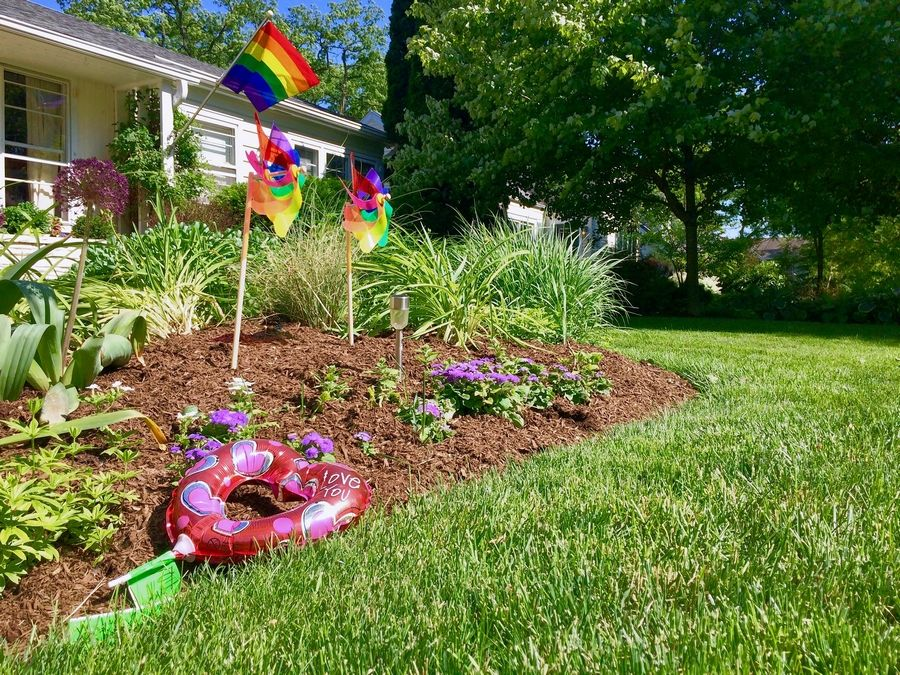 People have dropped off tokens of support, including these rainbow pinwheels and a small balloon heart, at a Barrington home after a high school student living there was the target of vandalism now being investigated as a hate crime.