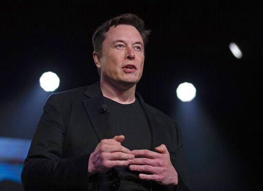 FILE - In this March 14, 2019 file photo, Tesla CEO Elon Musk speaks before unveiling the Model Y at the company's design studio in Hawthorne, Calif. Musk will face the electric car maker's shareholders during the company's annual meeting on Tuesday, June 11.