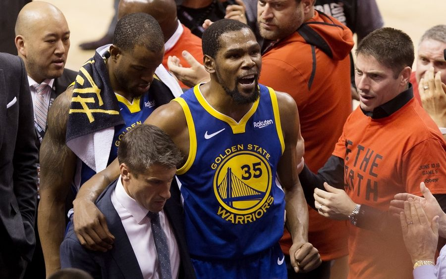 Golden State Warriors forward Kevin Durant (35) reacts as he leaves the court after sustaining an injury during first-half basketball action against the Toronto Raptors in Game 5 of the NBA Finals in Toronto, Monday, June 10, 2019.